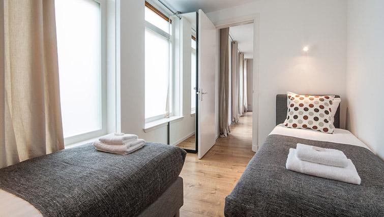 Compact bedroom at De Pijp Apartments, Amsterdam - Citybase Apartments