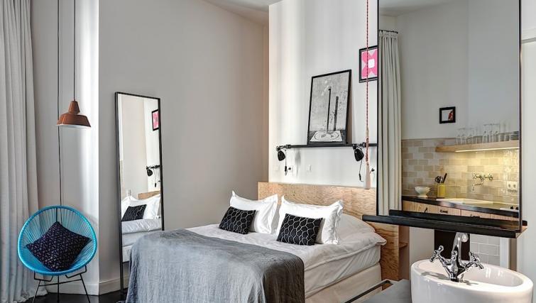 Comfortable bedroom at Gorki Apartments - Citybase Apartments