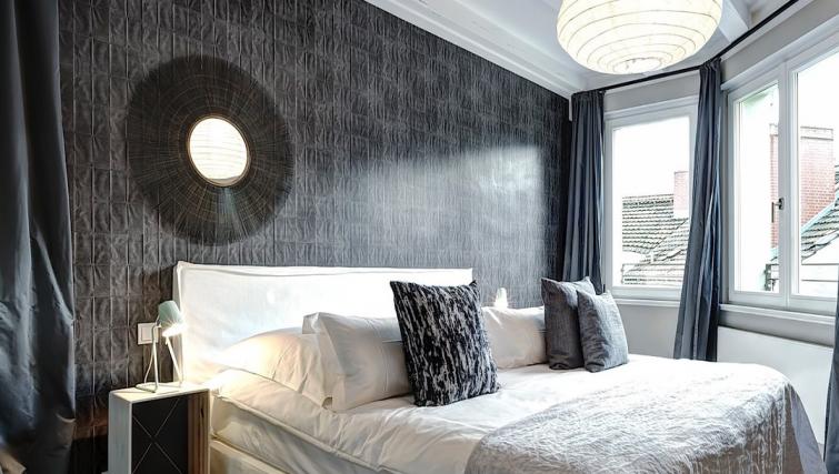 Bed at Gorki Apartments - Citybase Apartments