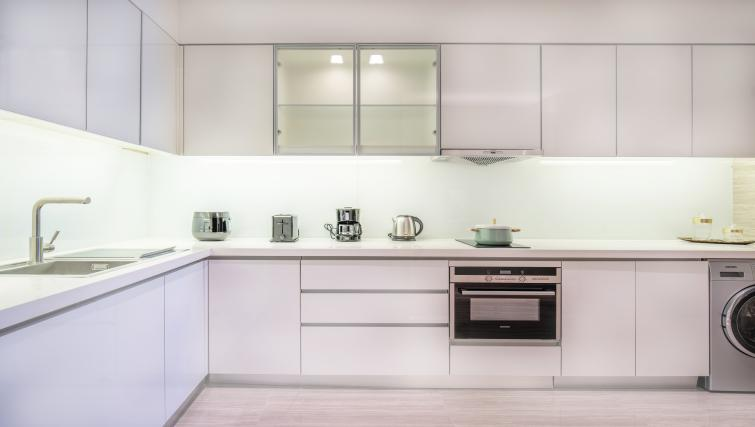 Equipped kitchen at Oakwood Residence Damei Beijing - Citybase Apartments