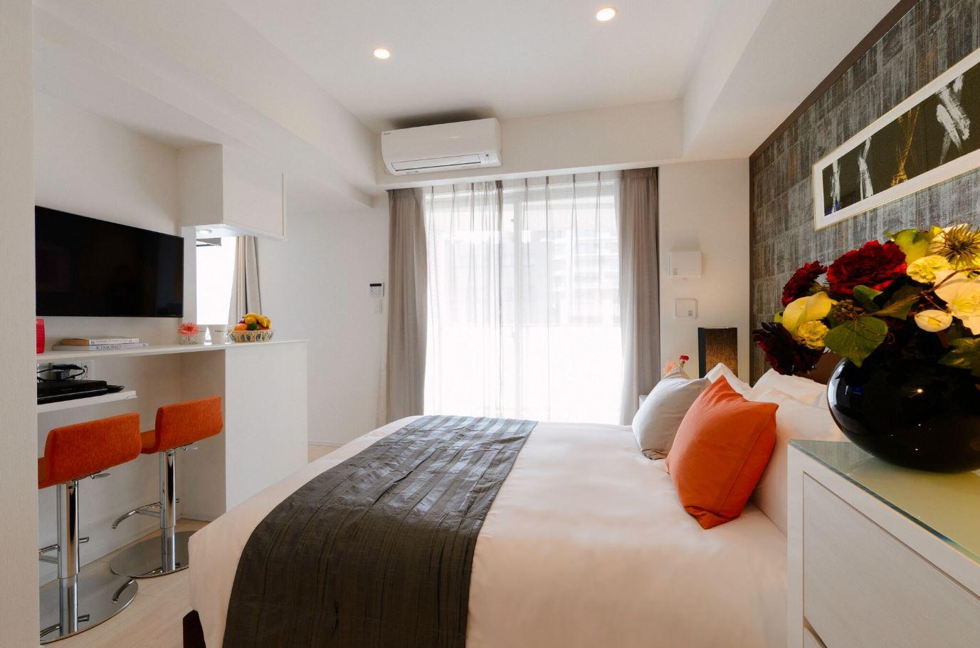 Comfortable bed at Oakwood Apartments Minami Azabu Apartments - Citybase Apartments