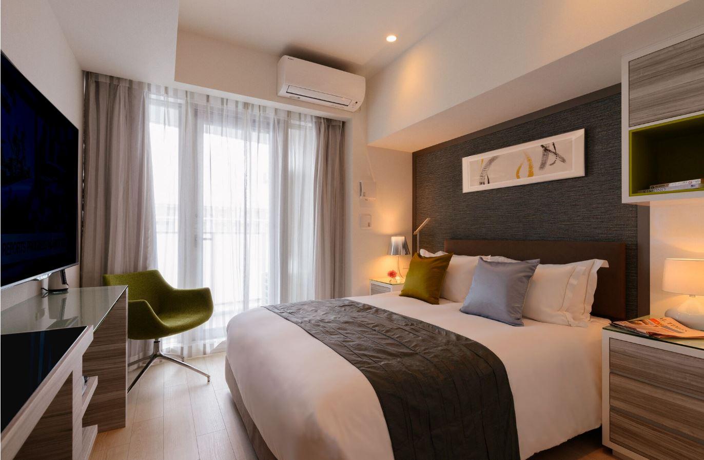 Double bed at Oakwood Apartments Minami Azabu - Citybase Apartments