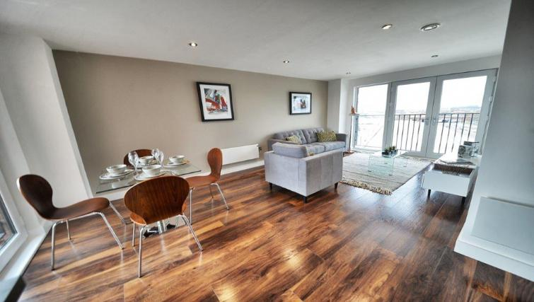 Dining table and lounge area at Apartments at Wilburn - Citybase Apartments