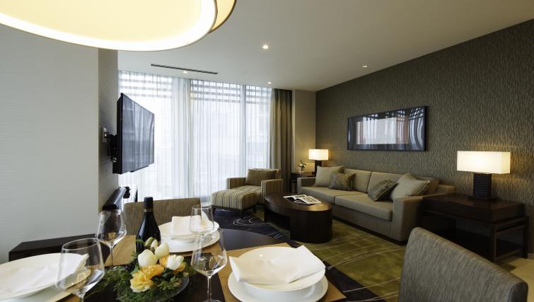 Living area at Oakwood Premier Tokyo - Citybase Apartments