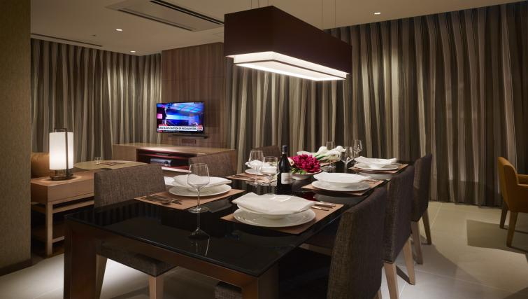 Dining area at Oakwood Premier Tokyo - Citybase Apartments