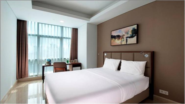 Bed at Oakwood Apartments La Maison Jakarta - Citybase Apartments