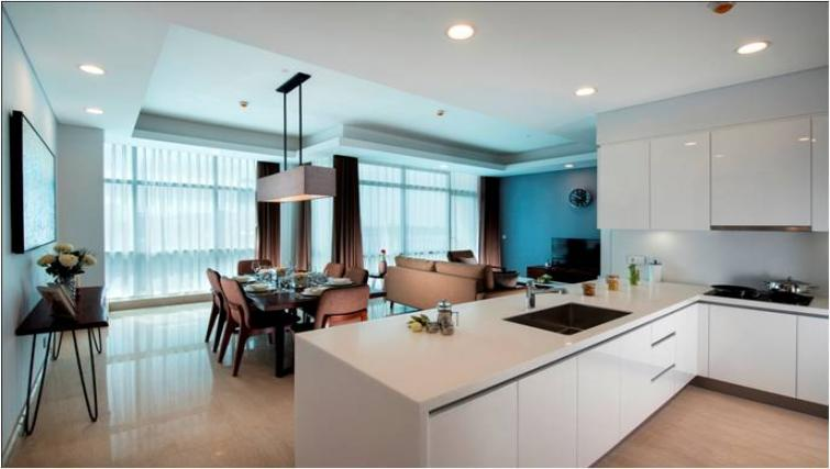 Modern kitchen and spacious dining area at Oakwood Apartments La Maison Jakarta - Citybase Apartments