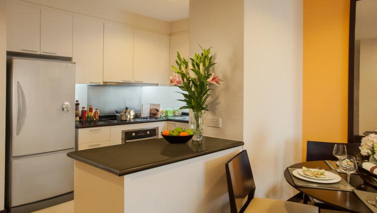 Kitchenette and dining table at Somerset Hoa Binh Apartments - Citybase Apartments
