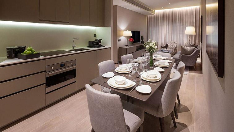 Equipped kitchen at Oakwood Premier OUE Apartments, Singapore - Citybase Apartments